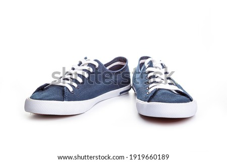 Convenient for sports mens sneakers in dark blue thick fabric. Presented on a white background. Сток-фото ©
