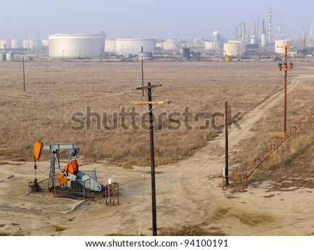Conventional energy is represented by an oil well pumping unit in the foreground and a refinery in the background
