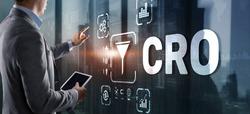 Conversion Rate Optimization. CRO Technology Finance concept Businessman pressing on a virtual screen.