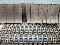 Conveyor. Transport tape made of chains, shafts, rubber bands.