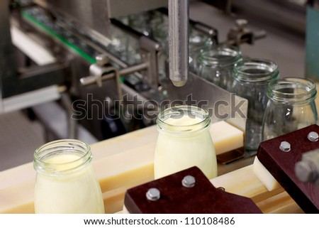 Conveyor with bottles filled with milk products