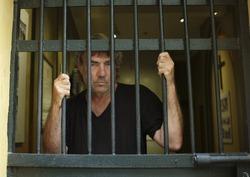 Convicted felon in jail