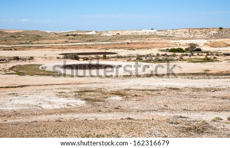 Coober Pedy golf course arid lunar landscape, Mad Max filmed here, tees are oiled sand Stock fotó ©