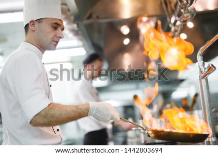 cook cooks in a restaurant #1442803694
