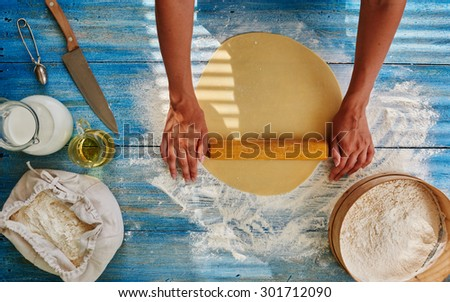 Cook in a trendy Italian restaurant rolls the dough to cook from Spaghetti, Girl Roll out the dough to cook from it that pie fillings or pizza