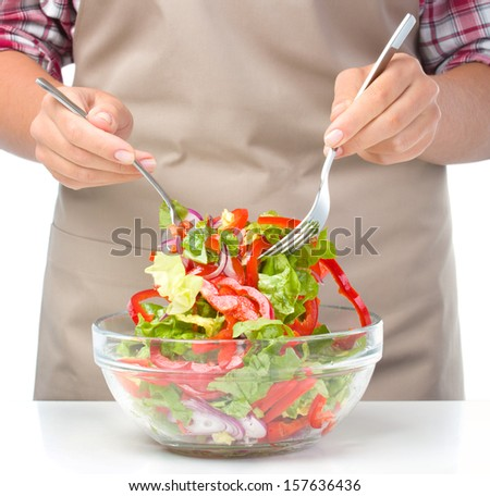 Cook is mixing fresh summer salad, closeup shoot