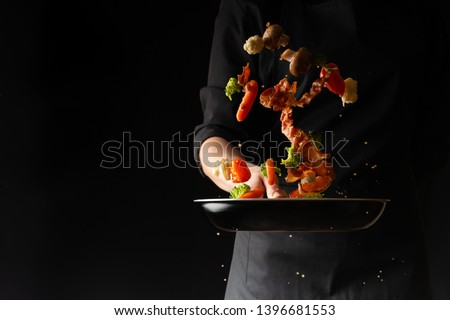 Cook preparing bacon slices with garlic and hot pepper and broccoli in a pan, freezing in the air, on a black background, recipe book, menu, gastronomy, culinary background #1396681553