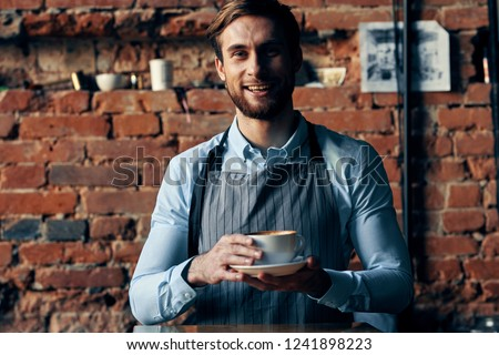 cook with a cup of tea in hand