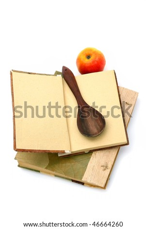 Cookbooks, apple and spoon isolated on white background. Place for your recipe