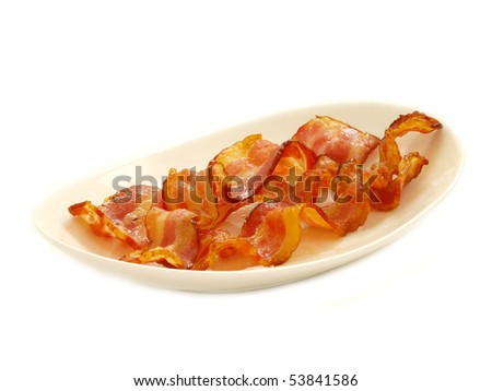 cooked bacon in plate isolated