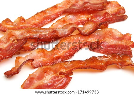 Cooked bacon strips on white background