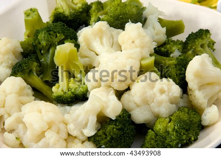 cooked broccoli and cauliflower in closeup