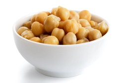 Cooked chickpeas in white bowl isolated on white.