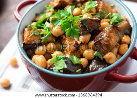 Cooked chickpeas with eggplants and parsley. Oriental food, vegetarian food.