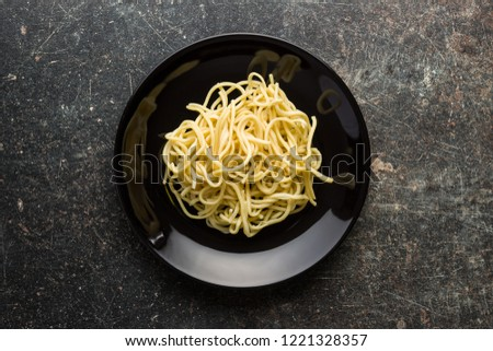 Cooked chinese noodles on plate. Flat view.