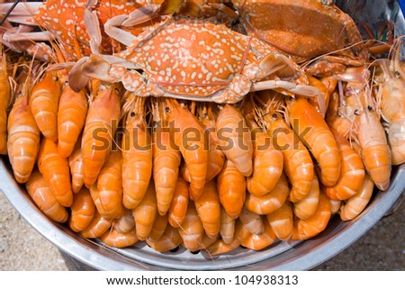 Cooked crabs and shrimps on the market of Thailand