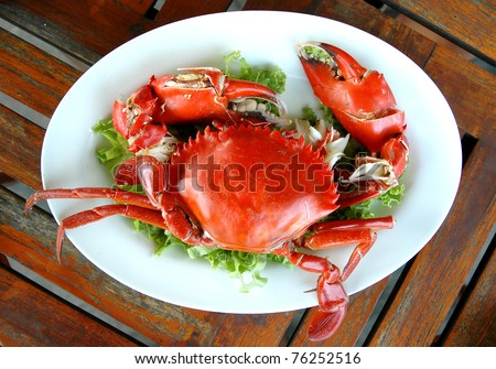cooked crabs on white plate