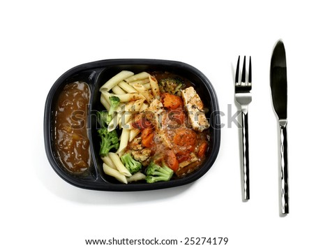 Cooked Frozen Dinner with Knife and Fork