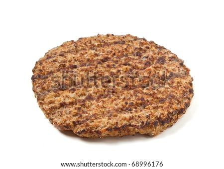 Cooked minced beef patty isolated on white background