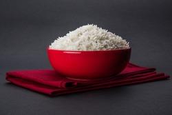 cooked plain white basmati rice in a ceramic bowl