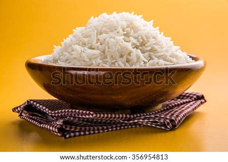 cooked plain white basmati rice served in a wooden bowl, isolated over colourful or wooden background #356954813