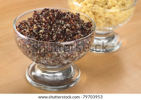 Cooked red and white quinoa in glass bowls which can be eaten as a side dish like rice and is rich in proteins (Selective Focus, Focus on the front of the red quinoa)