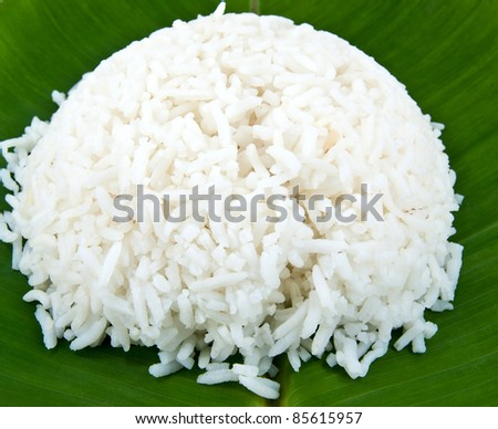 Cooked rice on banana leaf. - stock photo