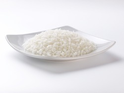 cooked rice on plate and white background