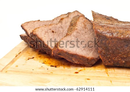 cooked roastbeef on a wooden board isolated