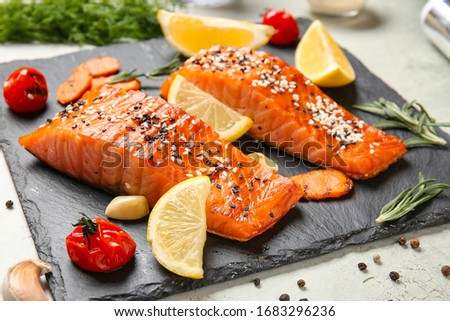 Cooked salmon fillet and vegetables on slate plate ストックフォト ©