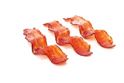 Cooked slices of bacon on white background