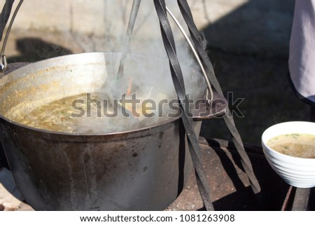 Cooked soup in large pot #1081263908