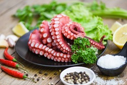 cooked squid salad chili sauce seafood cuttlefish dinner restaurant, Boiled octopus tentacles, Octopus food on wooden background