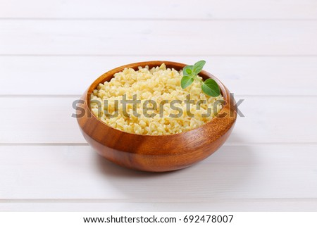 Cooked whole groats in wooden bowl Stockfoto ©