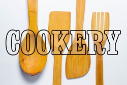 cookery. Wooden kitchen utensils on a white background, from above the inscription