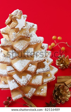 cookie christmas tree on a red background , greeting card design