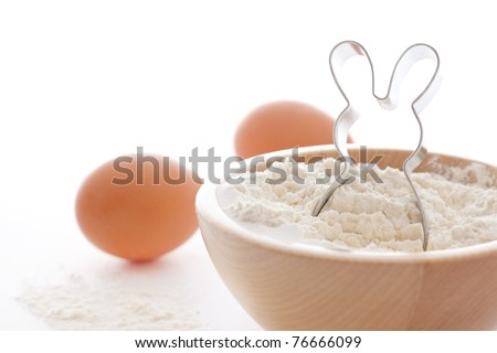 cookie cutter farina and eggs on white background