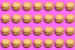Cookie sandwich pattern with a shadow on a pink background. Prints, templates.