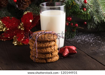 Cookie with milk on the table for Santa Claus