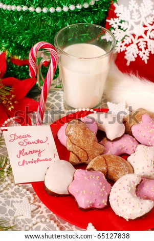 cookies and glass of hot milk waiting for santa claus on the table