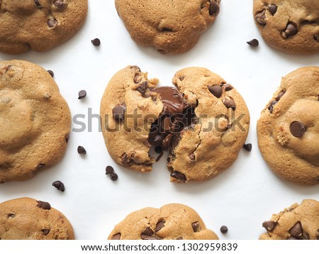 Cookies arranged with inner chocolate nutella melt. Stylized chocolate chips cookies.