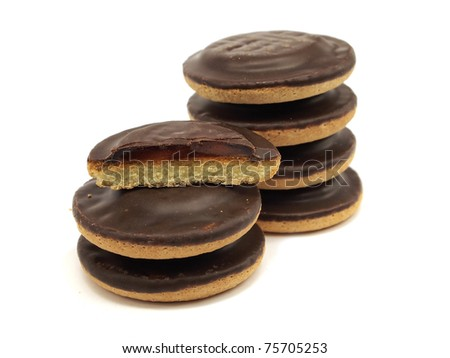 Cookies covered with chocolate and filled with jam on white background