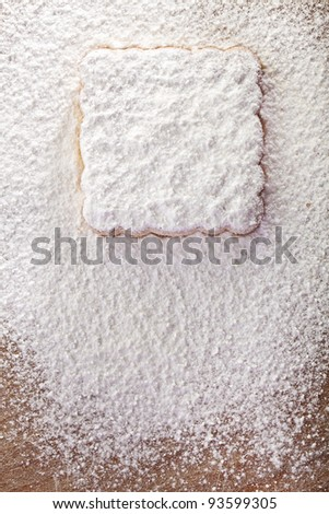 Cookies covered with powdered sugar, background for congratulations