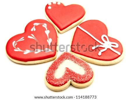 Cookies decorated with heart shape on white background