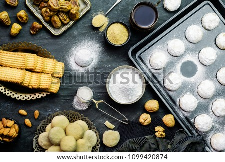 Cookies for celebration of El Fitr Islamic Feast (The Feast that comes after Ramadan) .Served with cup of tea.Top view with close -up.