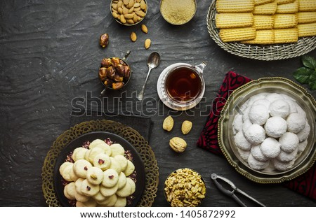 Cookies for celebration of El-Fitr Islamic Feast(The Feast that comes after Ramadan). Varities of Eid Al-Fitr sweets (Kahk-Gorayeba-Biscuits)Served with roasted nuts and cup of tea.