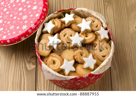 Cookies in a tin on a wooden background