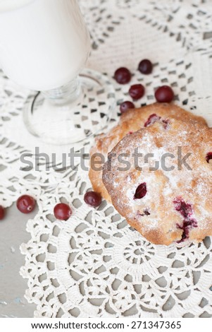 cookies in powdered sugar with cranberries and milk