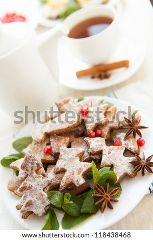 Cookies in the form of Christmas trees and a cup of tea, close up - stock photo