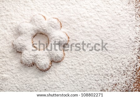 Cookies in the shape of a flower covered powdered sugar, (background for congratulations)